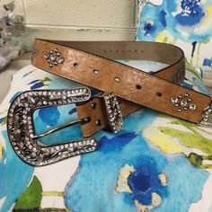 Beautiful women's blingy belt. Hearts, wings, and lots of bling adorn this women's fashionable belt. This is a size large, which fits up to a size 38 waist. This belt is beautiful. Nocona Other