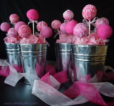 pink cake pops in tin buckets. cute for a baby shower. do blue for a little boy!
