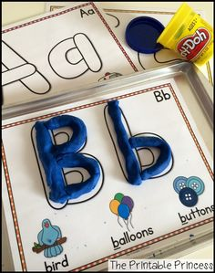 "Play dough alphabet mats. LOVE how the letters are shaped like play dough ""snakes""!"