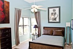 The enormous 14' ceilings add to the roomy feel of the master bedroom. http://teamwoodall.com/greens/