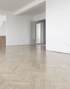 time of the aquarius: Restored old herringbone parquet done with white-tinted lacquer.