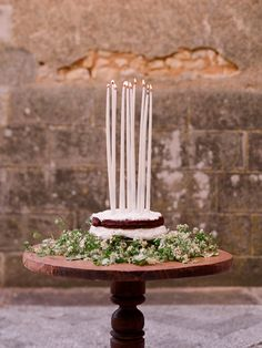 A rustic country cake with long tapered candles