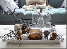 winter table display...I especially love the little kitty sleeping on the couch in the background <3