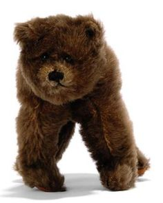 A STEIFF BEAR ON ALL FOURS, (1315?), standing, brown mohair, black boot button eyes, black stitching, inoperative squeaker and FF button, 1920s --8¾in. (22.5cm.) long (some slight wear and fading)