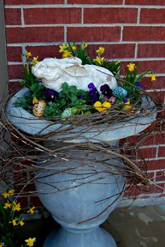 spring planter - so so cute! I have the exact bunny. Have to find the urn planter though.