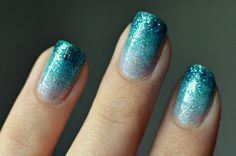 turquoise ombre glitter nails.