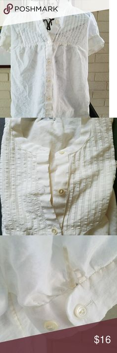 "Cute Small Blouse Button Up Cap Sleeves in Cream This Banana Republic cream colored blouse is just adorable. A smocked bib front, cuffed cap sleeves and beautiful mother-of-pearl buttons. A peter pan collar. The 72 % cotton 28% silk blend fabric is soft and slightly sheer with a subtle sheen. Lovely!  In excellent previously owned condition.  So sweet with a skirt or dress up a pair of jeans with this classic top.  Measurements flat: 18"" across chest under the arms  25"" long from shoulder to…"