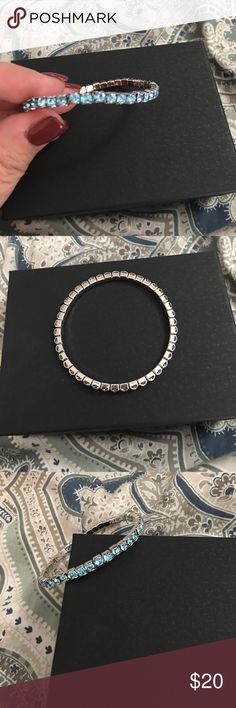 Touchstone Crystal by Swarovski Bracelet Touchstone Crystal by Swarovski stretch bracelet. Never worn. Comes in sheer pouch. No Box. Looks great with multiple ones stacked. Aquamarine (March Birthstone). 🚫NO TRADES🚫, 💰BUNDLE AND SAVE💰, ✅REASONABLE OFFERS CONSIDERED VIA OFFER BUTTON ONLY✅ Swarovski Jewelry Bracelets