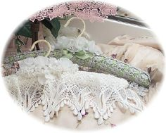 I could turn some of my vintage linens into padded hangers--it would show off the handmade edgings wonderfully.