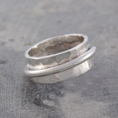 Click here to buy your own gently hammered silver band ring (encircled by a loose fitting ring). The movement created makes it impossible not to twiddle! #Jewellery #ring #silver #accessories