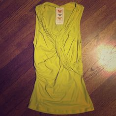 Anthropologie knit tank. Fun, bright top with twisted neckline and ruched sides. Deletta Tops Tank Tops