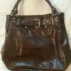 Barneys New York gorgeous Brown Leather handbag One snap closure .Interior pocket . Buckle designed front . Double strap Barneys New York CO-OP Bags Satchels