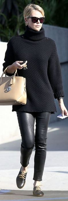 Who made  Charlize Theron's black cardigan sweater and tan handbag?