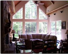 Excellent Window Film Ideas for Sophisticated Tech in Interior: Luxurious Smaller Family Room With Reclaimed Wood And Stone Framed Fireplace. Window Film, Window Seats, Triangle Window, Deck Railings, Exterior Remodel, The Ranch, Dream Big, Dining Area, Family Room