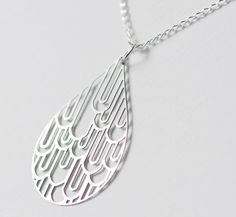 From my Sketches in Steel collection. This stunning raindrop has been fashioned from industrial stainless steel and hung from a sterling