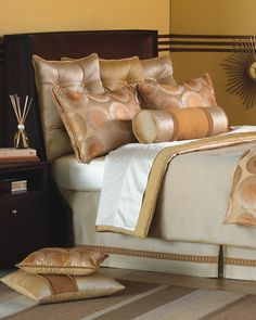 satiny elegance in earth tones and lots of pillows
