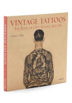 If you're drawn to classic body art, you'll delight in every bold detail of this anthology of tattoo imagery! Collected by music writer Carol Clerk, this paperback traces the history of tattoos through the 19th and 20th centuries.