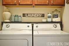 container for homemade laundry soap and laundry softener laundry room decor. Use chalkboard decals on ceramic jars or glass urns Laundry Closet, Laundry Room Organization, Laundry In Bathroom, Laundry Shelves, Laundry Rooms, Small Laundry, Laundry Decor, Laundry Area, Laundry Tips