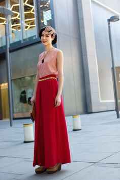 Karen Leung, the founder of Beijing luxury vintage shop House of Willow, models a look from the shop. (Courtesy Photo)