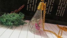 Pingentes feito à mão. #biojoias #miniterrarios #flores #bijuterias #dentedelao