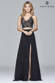 Faviana 7996 is your one-of-a-kind dress for a once-in-a-lifetime event. Adjustable spaghetti straps and a lace-up back make the lace applique covered bodice of this trendy two piece dress exceptional. Paired with the lace top is a simple, pleated chiffon skirt with a slit. Don't forget to wear the pieces separately to get even more wear out of this amazing dress!