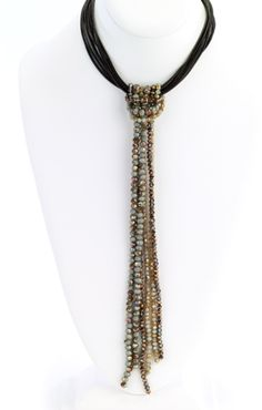 Multiple rows of leather strands with a long beaded tassel. Length: 12'' with Lariat Green...