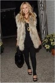 Rachel Zoe, known for her style, best defined as 70's bohemian glamour.