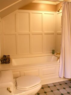 Have you ever seen the walls surrounding a bathtub paneled with corian?  I never had until we purchased are old home nine years ago.
