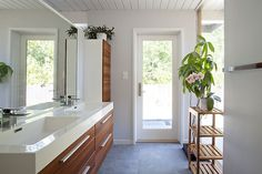 #WoodCeiling #TileFlooring #DualVanity #ExposedBeams #Window #GlassPaneDoor #SingleHandleFaucet #Bathroom