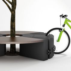 Mobiliário - Banco e bicicletário à sombra de uma árvore