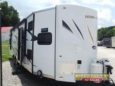 2015 New Forest River Rv Work and Play 28VFKS Toy Hauler in Ohio OH.Recreational Vehicle, rv, 2015 Forest River RV Work and Play 28VFKS, The Work and Play 28VFKS toy hauler travel trailer by Forest River offers a single slide and a front kitchen.Stepping inside the trailer, to the right there is a refrigerator, extra counter space, a two burner range, and a sink. The sofa is on a slide.The side aisle bath offers a toilet, sink, and shower.In the cargo space you will be able to store your off…