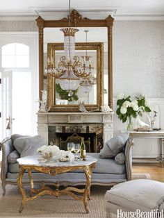 """The mantel shelf of designer Annie Brahler's Jacksonville, Illinois house, holds one of the her """"extreme juxtapositions"""": a massive empty picture frame, propped against the mirror."""