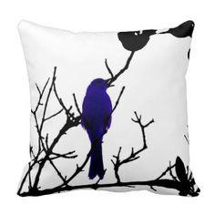 Blue bird on black tree throw pillow