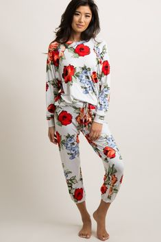 0f6107abdf A pajama set with a bright watercolor floral print. Top features a cuffed  style