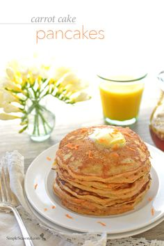 Carrot Cake Pancakes - Tempt your little Easter bunnies with these light and fluffy Carrot Cake Pancakes drizzled in a maple-walnut syrup. It's the perfect way to welcome the spring season!
