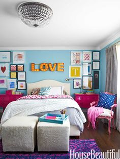 Hot-pink accessories in a teenager's room, with walls painted in Benjamin Moore Aura in Pool Blue.