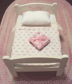 Materials: Duktig doll bedDescription: $105.95 for an American Girl doll bed vs. $20 a few supplies for re-doing the Ikea Duktig doll bed ($20). A happy outco