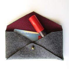 The Mini Felted Clutch; for no-sew, needs felt, leather, or similar material that doesn't require hemming; also needs specialized hardware (brass piece) or substitute