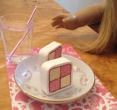Keep an eye out when you are in thrift stores and flea markets for things that can work as doll tableware. These shot glasses are a tad bigger than scale but were 25 CENTS each!!! The plate was part of an assortment of small plates, 7 for $3!
