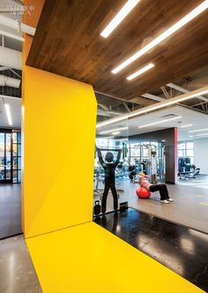 Gensler San Jose's Fitness Center for Symantec | At the end of the central corridor, the painted gypsum-baord panel conceals a structural column. #design #interiordesign #interiordesignmagazine #fitness @gensleron
