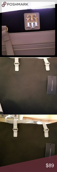 Tommy Hilfiger Tote NWT Excellent large purse with lots of pockets zip pockets on the outside beautiful color dark Navy and white large tote lots of places to put things back in her pocket out of pocket new with tags Tommy Hilfiger Bags Totes