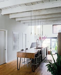#rustic Nicolas Gervais designed the pendant lights above the kitchen island, which was designed by Plasse and built by woodworker Stéphane Bilodeau.