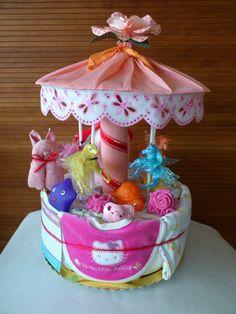 Merry go round carousel diaper cake Boy Baby Shower Themes, Baby Shower Parties, Baby Shower Decorations, Baby Shower Gifts, Baby Gifts, Baby Showers, Unique Diaper Cakes, Nappy Cakes, Baby Diaper Crafts