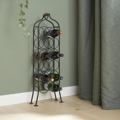Make a feature of your favourite tipples with this handcrafted wine rack, featuring a traditional design and space for 12 bottles.