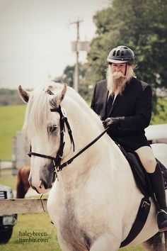 This is GREAT! Love it! If he can wear a helmet then so can you!!!!! His might need some Viking horns on it or something though!!