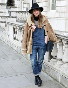denim overalls, faux sherpa lined coat and black booties and chapeau.
