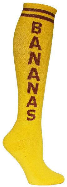 Yellow knee high socks with BANANAS in brown lettering and a cushioned footbed.  Unisex design: fits a women's shoe size 7 - men's 13.5.