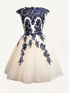 I think a wedding gown with this colored bodice detail, but with a long skirt, would be pretty.