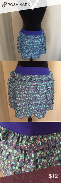 Forever 21 Blue Flower Print Ruffle Skirt Sz L EUC Forever 21 - I Love H-81. EUC only worn a few times. Size Large. Blue, Turquoise, Gray, and Purple Floral Printed Ruffle Skirt with Royal Blue Elastic Stretch Waistband. 100% Polyester. Fully Lined. Measures (flat): Length 15 in measures on the side), Waist 13.75 in (elastic stretch waistband). Juniors sizing. Fits like a misses small/medium; pants size 4/6. All items from a clean pet and smoke free home 🚫🐶🐱🚭 Forever 21 Skirts Mini
