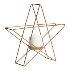 Illuminate your home in style with this gorgeous copper star-shaped pillar candle holder. This striking accessory would look great on a sideboard or your mantelpiece and will hold one pillar candle with a diameter of 7.5cm and a height of 15cm maximum. <BR>  <BR>It's part of our  Folk  Home range, a vibrant and  bohemian trend featuring bold patterns in a palette of rich reds and warm  browns.<BR><BR>Warning: <BR>Never leave a burning candle unattended and fo...